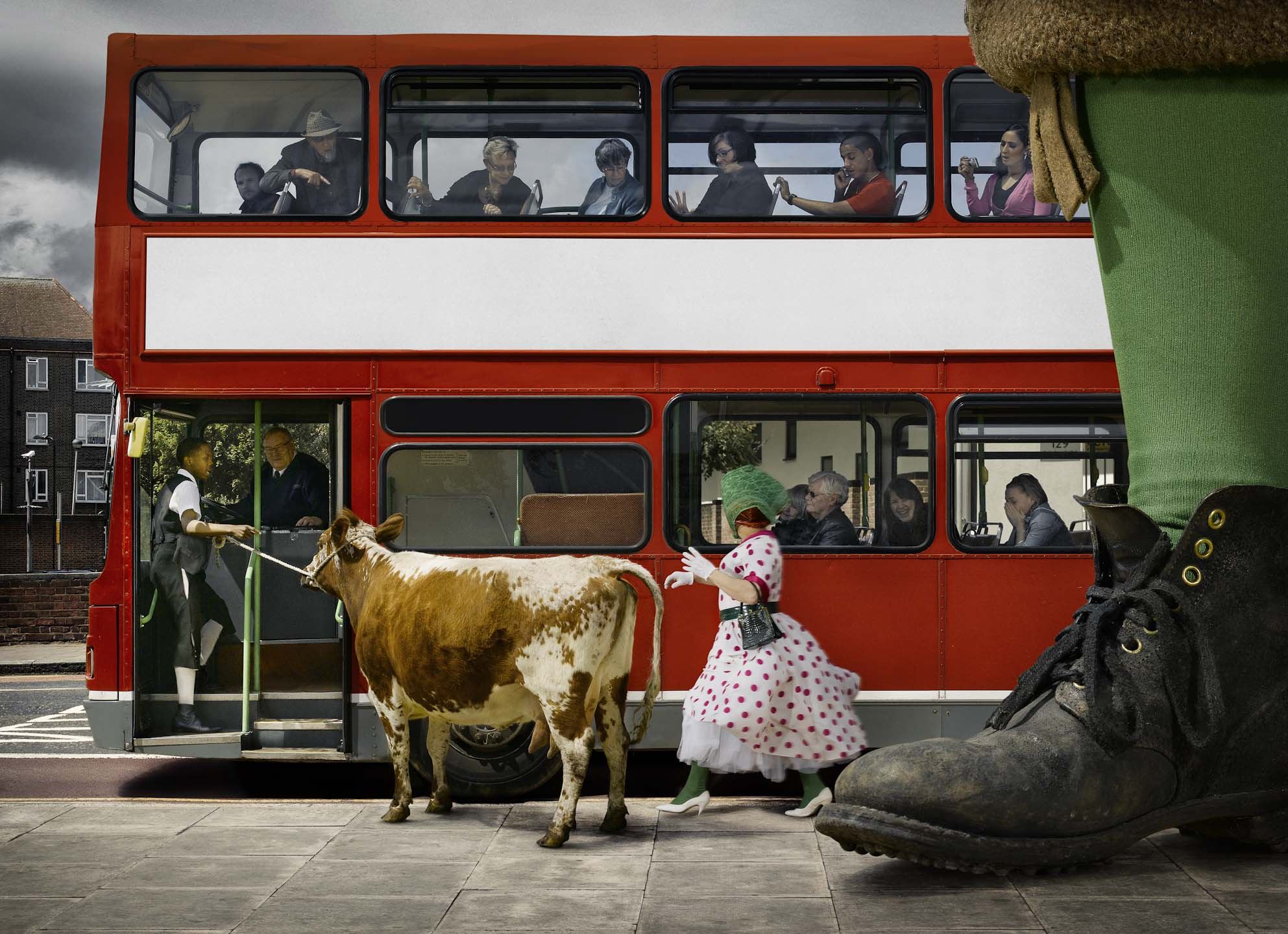 Alex Howe animal cow with fairy tale characters getting on red London  bus with onlookers