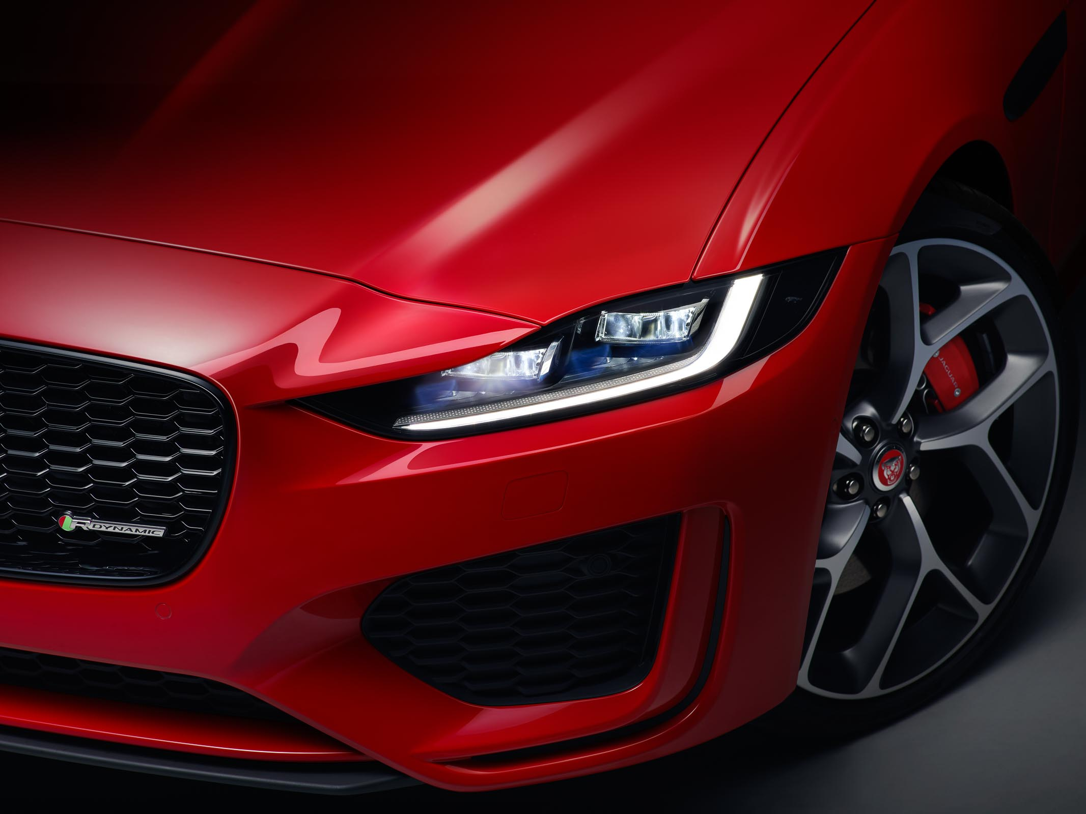 Jaguar_XE_Caldera_Red_RDynamic_Head_Light_On